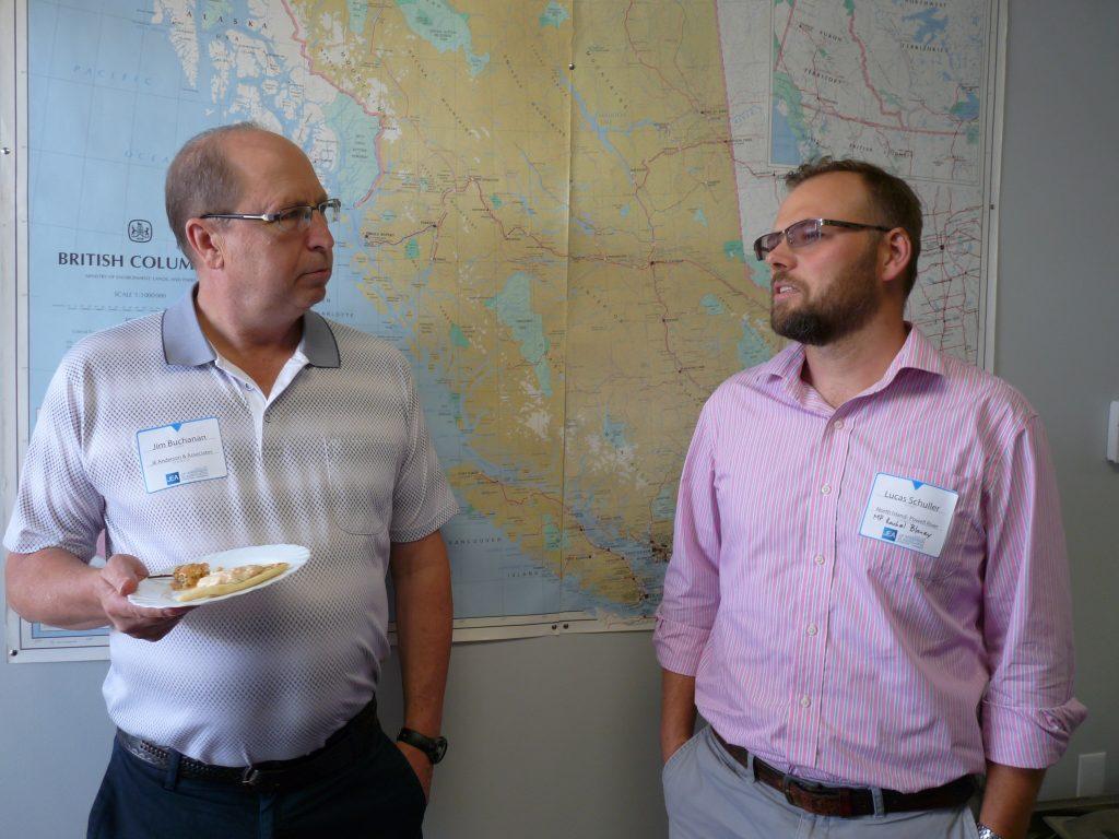 JEA Engineer Jim Buchanan (left) speaking with Lucas Schuller from MP Rachel Blaney's office