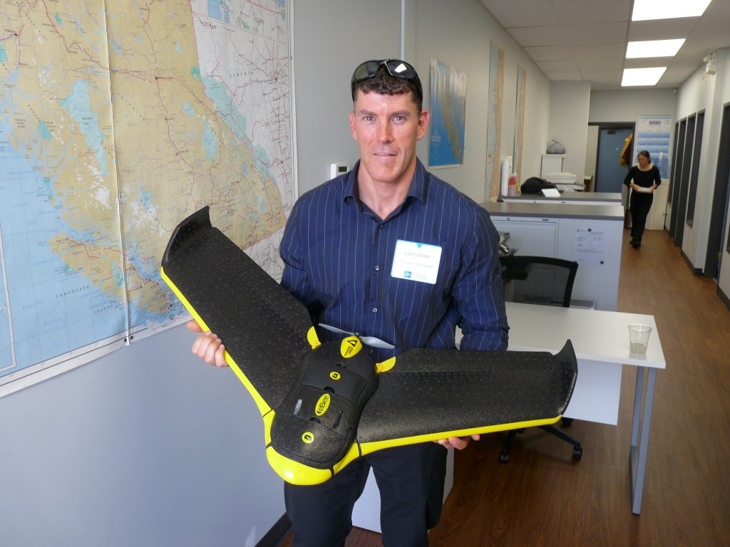 JEA Partner Colin Grover, BCLS holding the company's drone, used for surveying and engineering