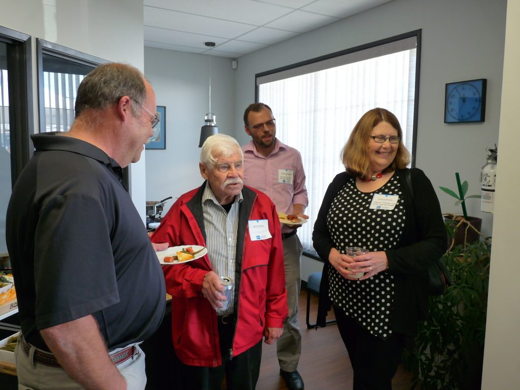 JEA Land Surveyor Colin Burridge speaking with Jack Chicalo (centre), as well as Lucas Schuller and Lynne Stone