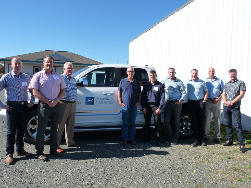 : Past and present Partners of J.E. Anderson & Associates gathered at the grand opening of the company's new Campbell River office (l-r) Ross Tuck, Jeff Tomlinson, Dave Wallace, Mike Manson, Colin Grover, Ryan Hourston, Doug Holme, Phil Buchanan and Scott Stevenson.