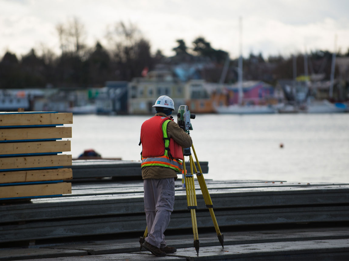 J.E. Anderson land surveyor working onsite at Victoria International Marina.